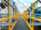 yellow grp handrail with walkway