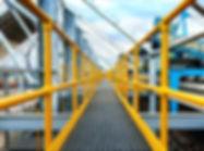 yellow grp handrail with walkway