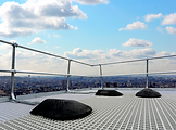 freestanding roof edge protection system installed on high roof on grating
