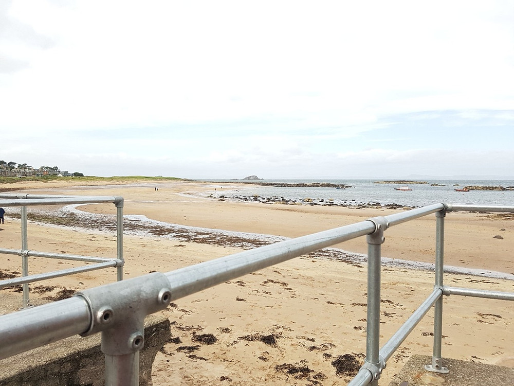 Galvanised tube and clamp fittings next to shore-side to access sandy beach