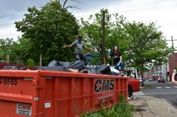 Darius with Scott Presler on dumpster
