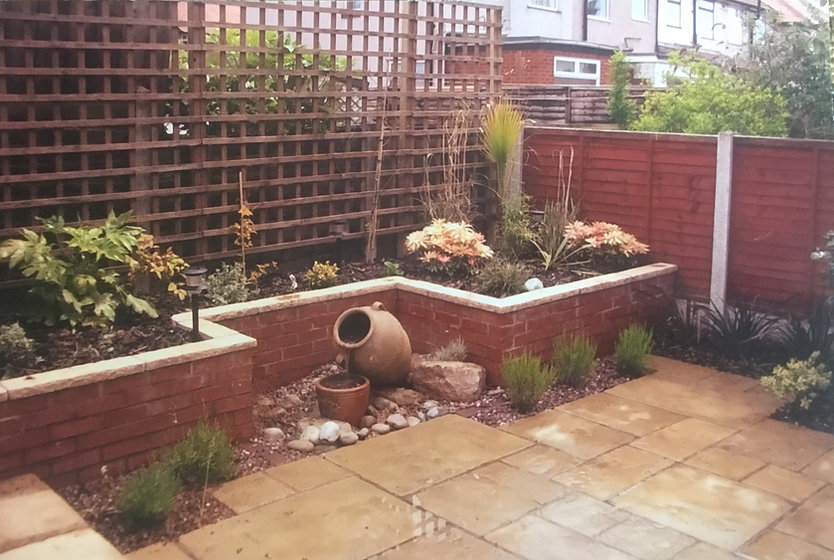 Raised border and water feature.jpg