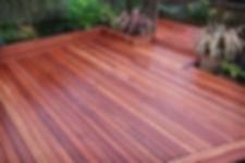 Hardwood decking installation in a garden we designed