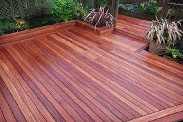 Hardwood decking installation in a garden we designed