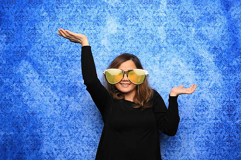 Blue Backdrop Photo Booth Pose