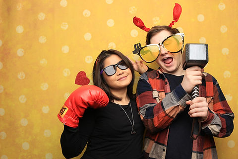 Yellow Backdrop Photo Booth Pose