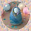 Womb Dreamer fertility doll felted in rainbow colours