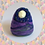 Womb Dreamer fertility doll felted in purple, green and blue colours