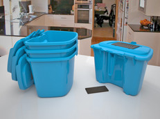 Range of brightly coloured kitchen caddy's for food waste with optional carbon filter for odors