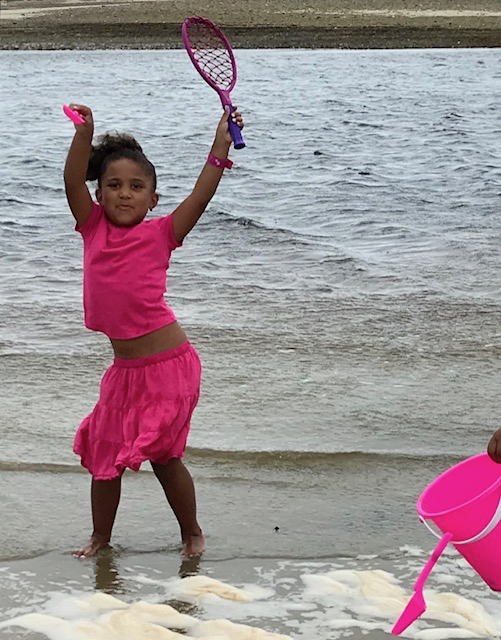 A granddaughter who knows that ocean wind is for dancing.
