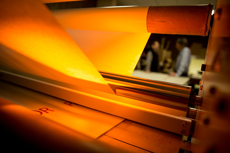 NovaColor can surface mount any print with hot or cold lamination.