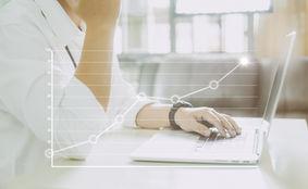 graphicstock-businessman-using-laptop-wi