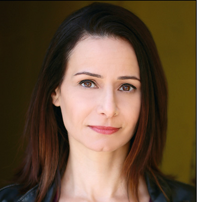 Roxanne Racitano plays Devin, the rough-edged but good hearted lesbian on Dive Shop The Show