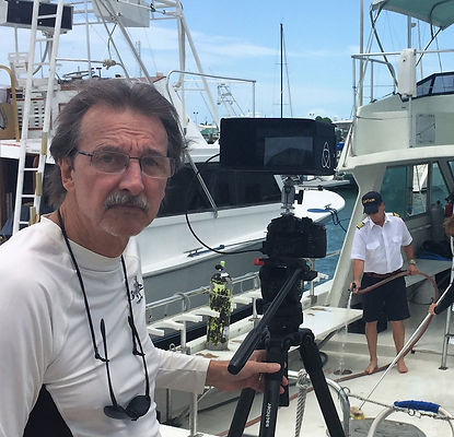Tom Jackson, Award-winning videographer and owner of Seascape Productions, filming Dive Shop The Show on location in Key West, Florida
