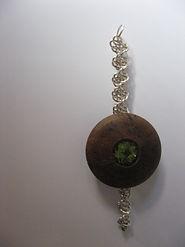 Tissage argent plus bois incruste d'une pierre gemme