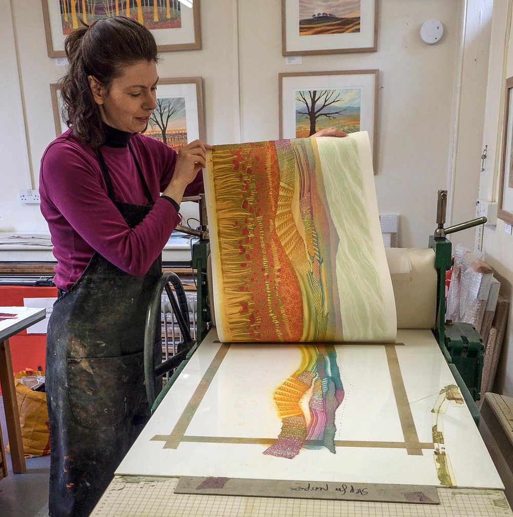 Rebecca Vincent printing Poppy Field monotype