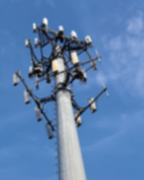Telecoms cell phone tower and blue sky.j