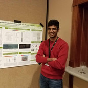 Karthik posing with his poster @ the 2019 dept retreat