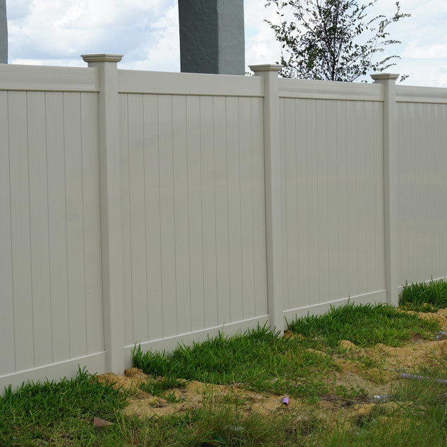 Tan Privacy Fence with New Englad Caps