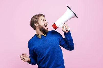 Cheerful man shouting into megaphone_edited.jpg