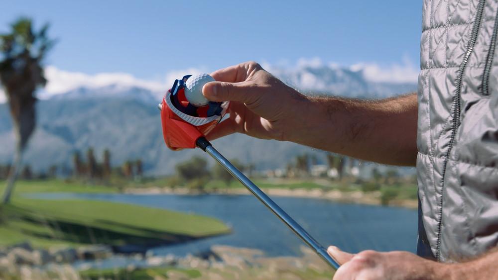 Man putting golf ball in Swing Coach Club
