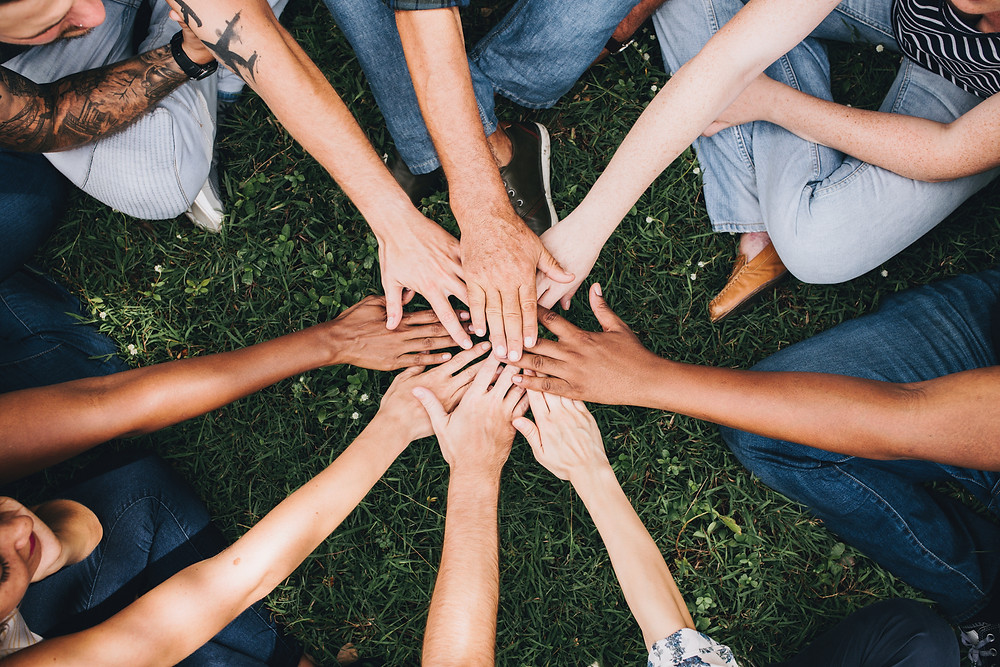 A circle of hands coming together. A circle of friends.