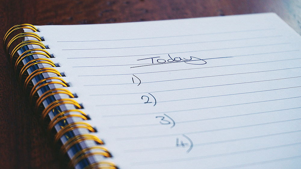Notebook with a blank list of today's tasks.