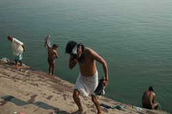 A group of men bathes in the Ganges River