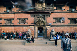 Locals relax in the complex of Patan Durbar Square