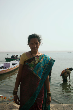 A portrait of Indian woman by the Ganges River