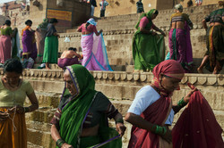 The ghat is a riot of colour as women dressed after puja ceremony
