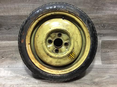 Dojezdové kolo - Mazda 323