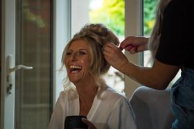 Bride-smiles-laughter-prep