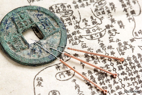 Chinese coin and acupuncture needles