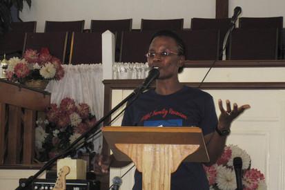 Mona speaking at reunion