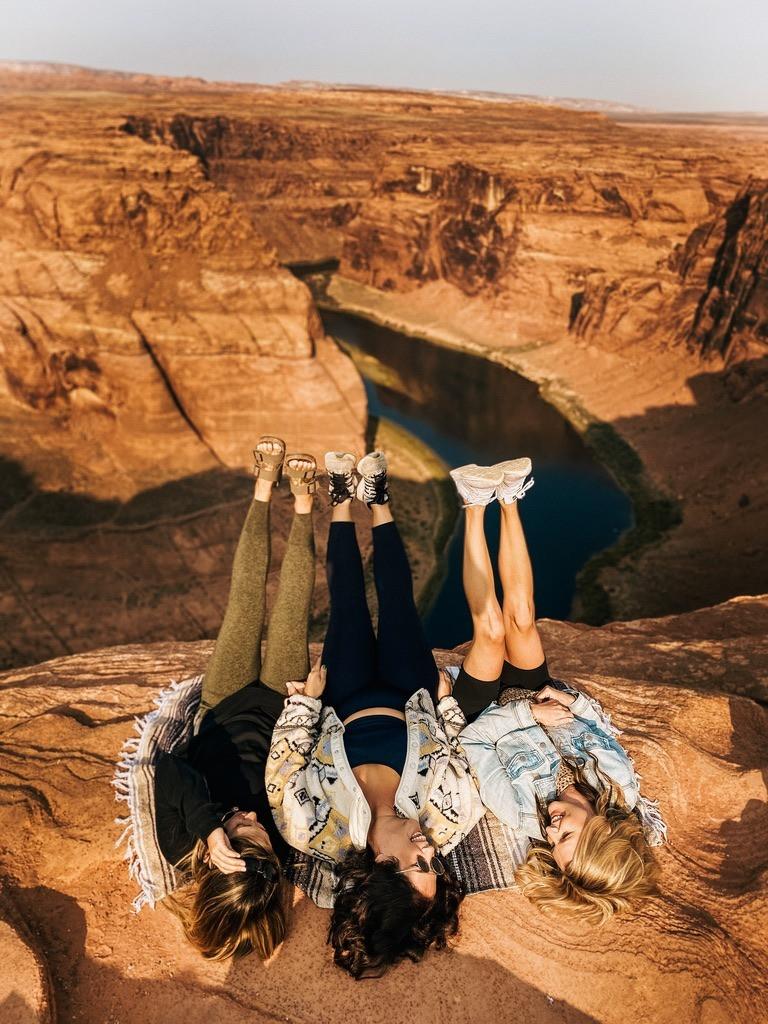 Horseshoe Bend arizona with the besties feet up so happy