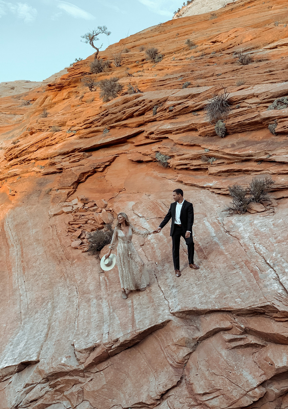 Zion scenic route scaling mountains dressed up couples shot