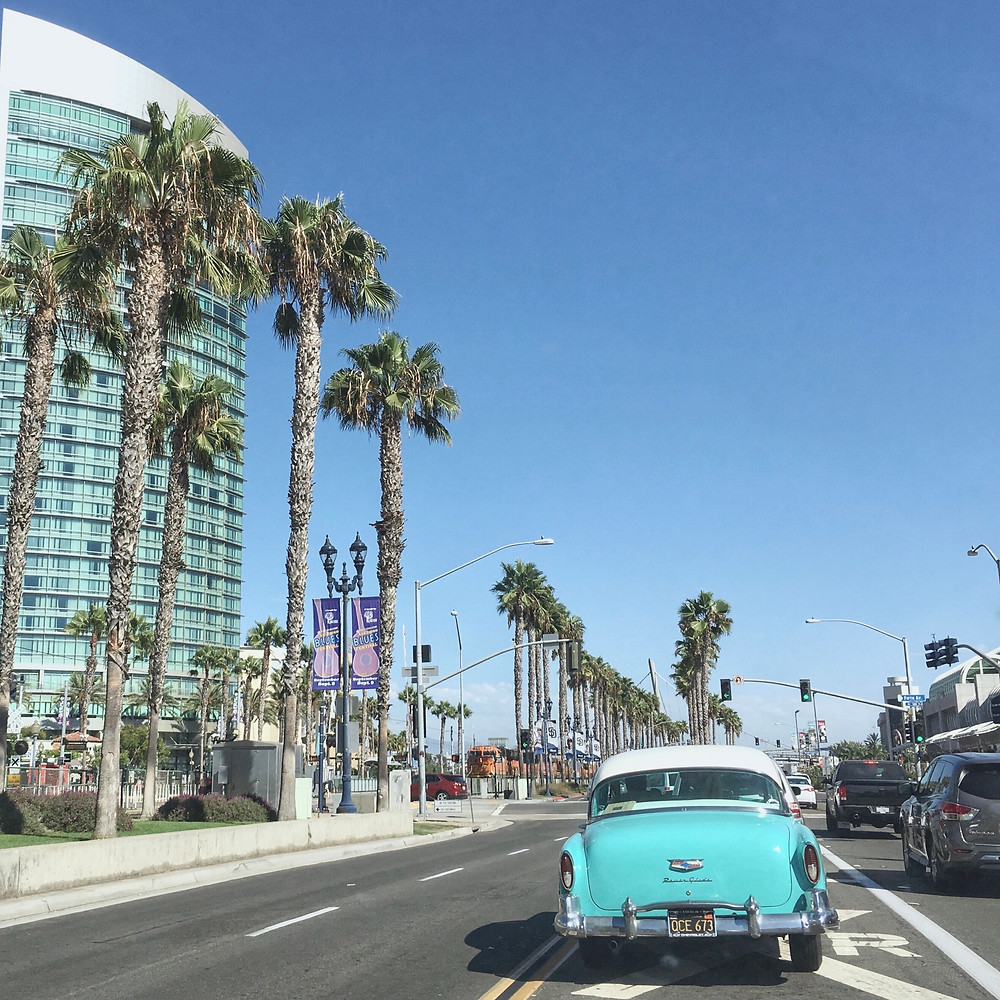 Driving a retro car by the palm treas in San Diego, alien thoughts, boston, international students blog, massachusets learner's permit, driver's license for international students