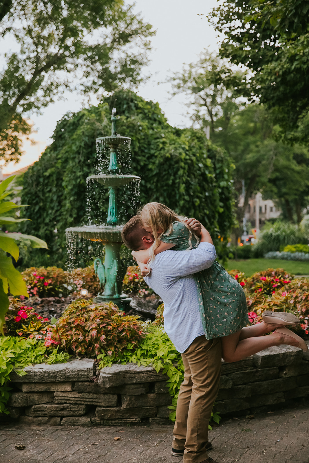A man and woman hug in Period Garden Park