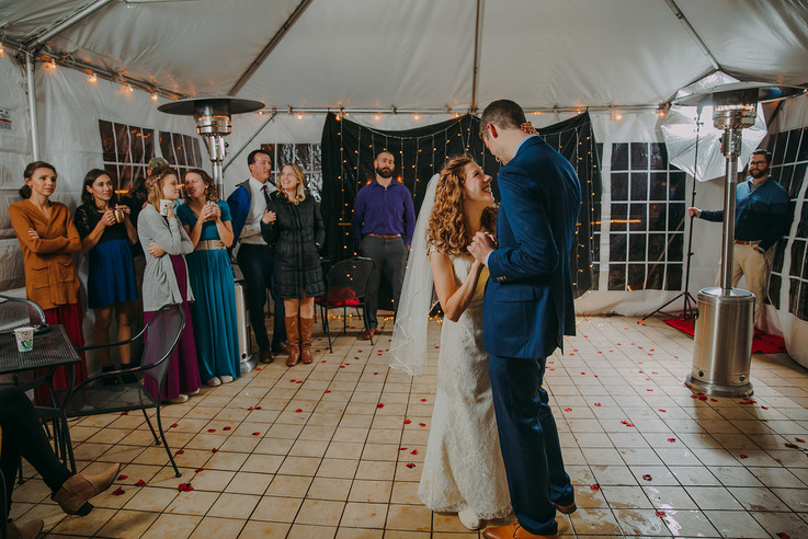 A man and woman share their first dance during a Milwaukee, Wisconsin fall wedding