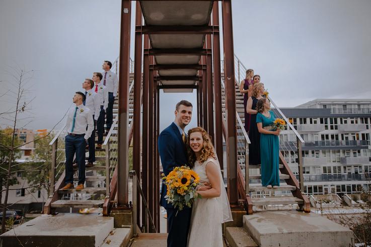 A wedding party poses on the bridge at Kadish Park in Milwaukee