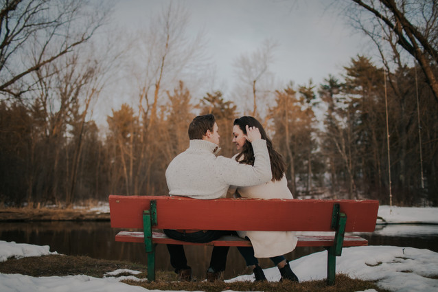 A man sits on a bench at Iverson Park during engagement photos