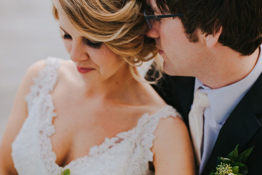 A close up of a bride and groom nuzzling during a Beckets Waterfront Atrium wedding