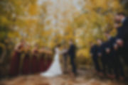 A bride and groom exchange vows at Quaking Aspen Amphitheatre at Warren Station