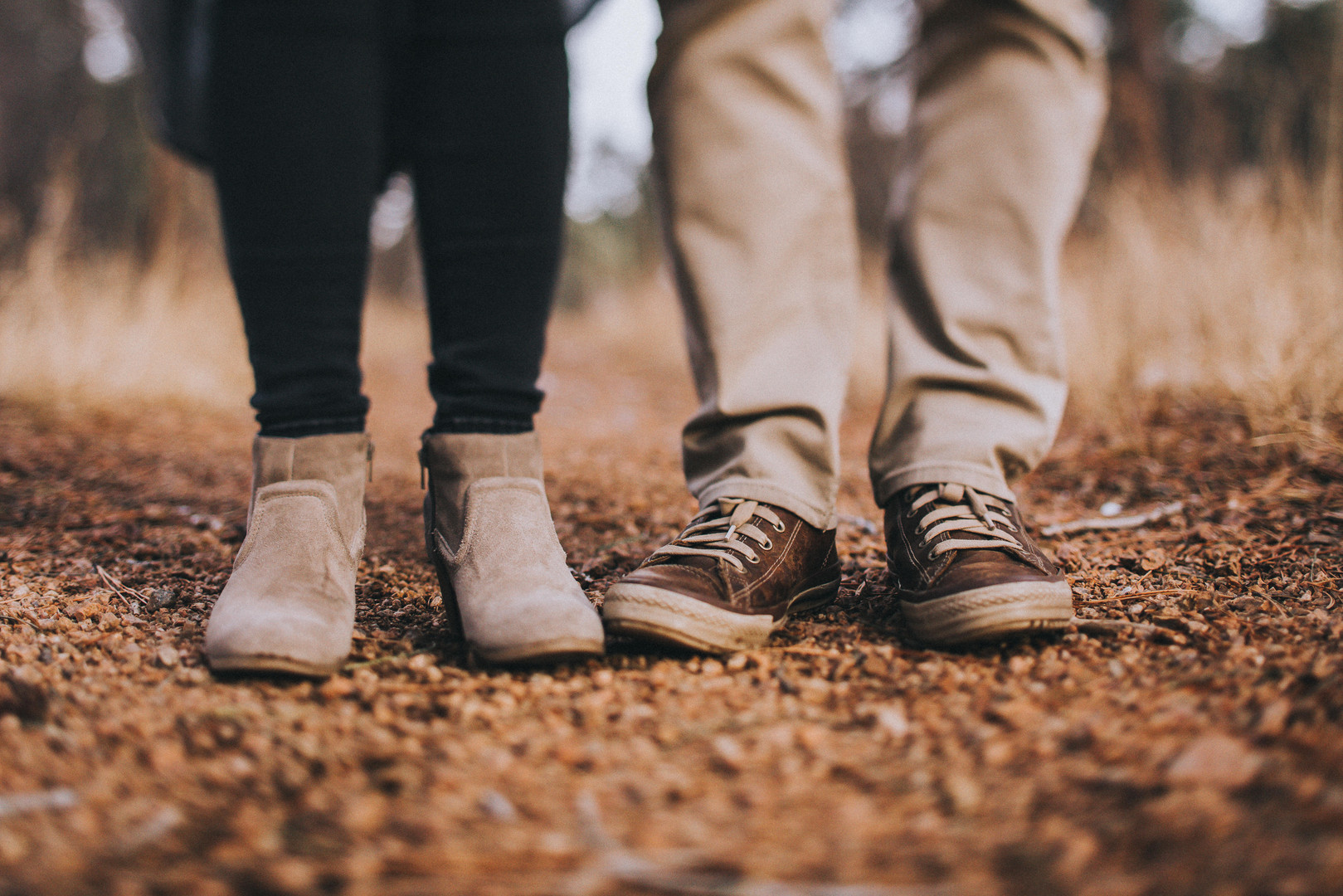 Am close up of a man and woman's shoes at a Cheyenne Mountain State Park engagement session