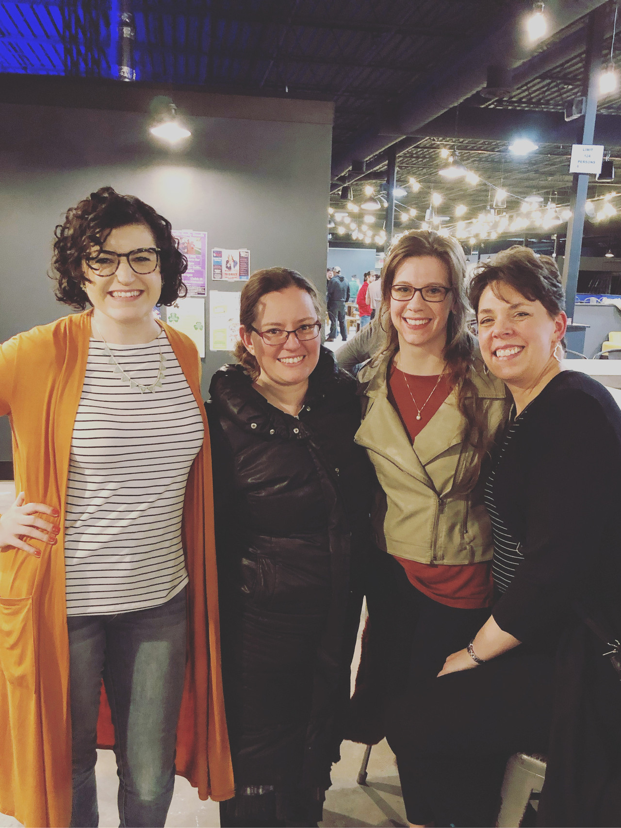 a group or women pose for a photo in District One Brewing Co.
