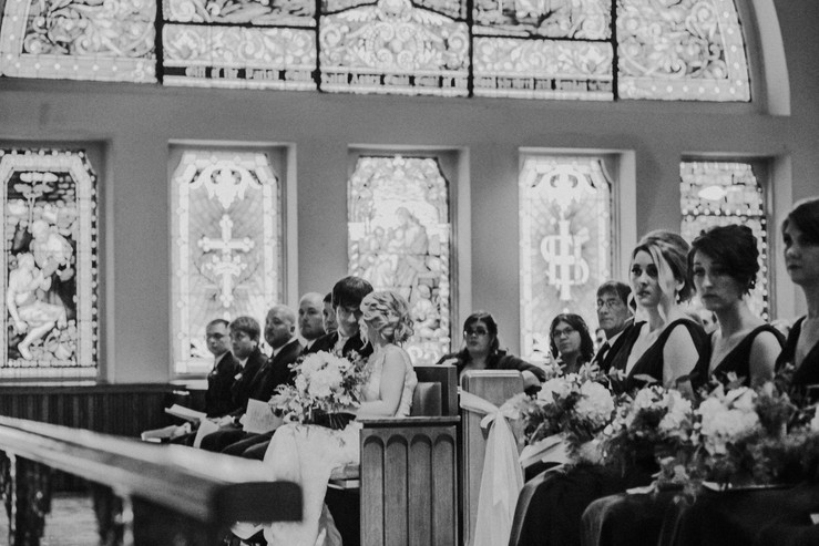 A bride and groom whisper to each other during Wisconsin wedding photography