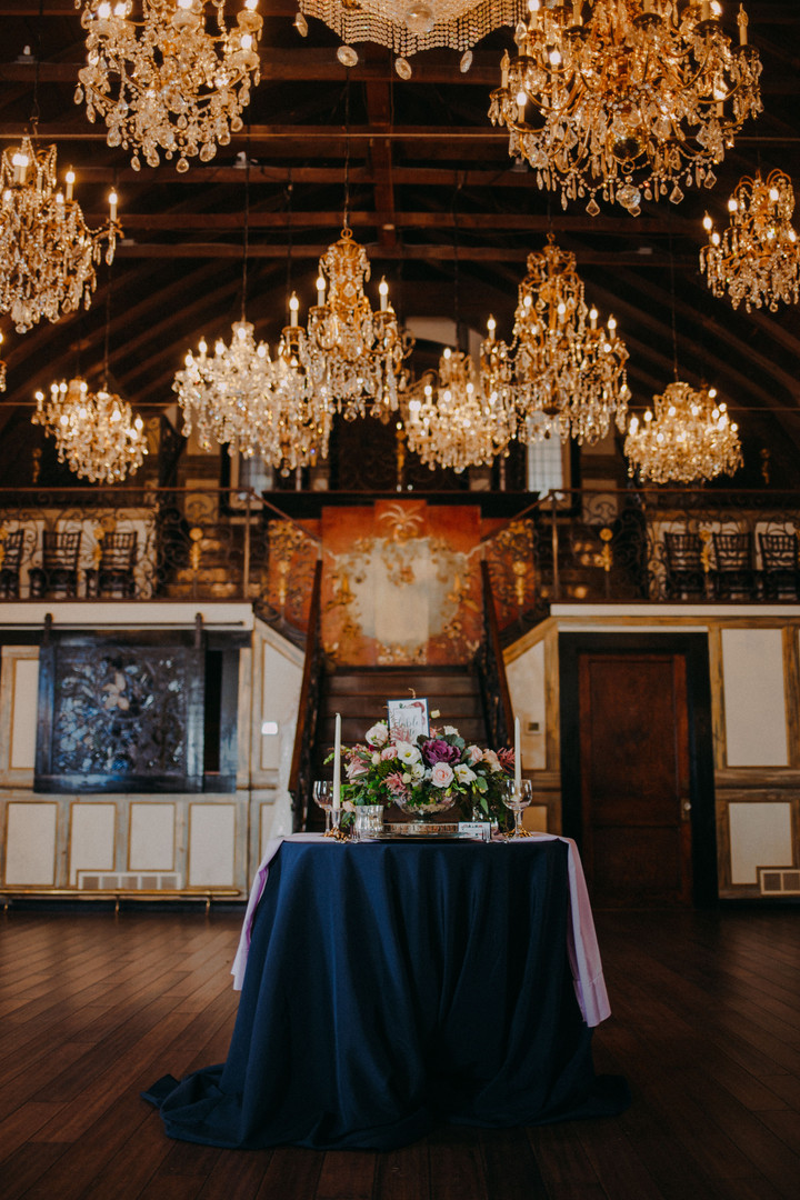 A tablescape with an elaborate flower bouqet at the Chandelier Barn
