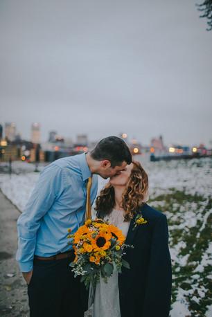A man kisses a woman at in Kadish Park