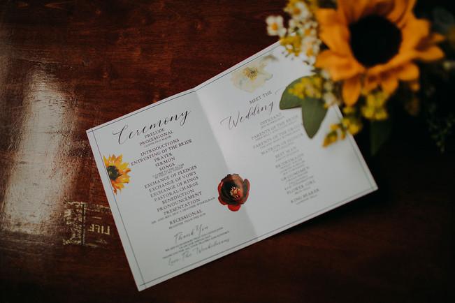 A closeup of a wedding ceremony program